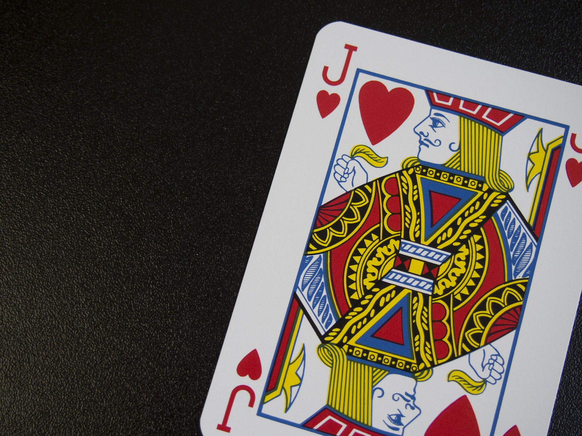 jack of hearts playing card on dark background